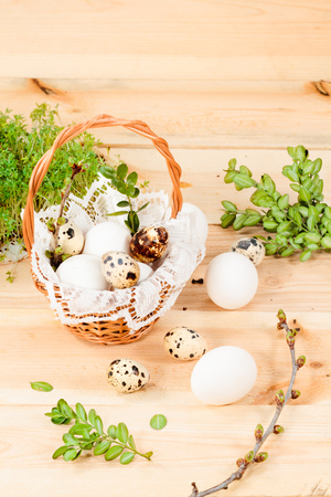 Preparing basket with eggs for blessing at Easter Stock Photo