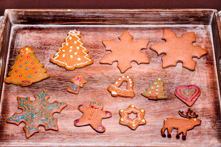 Christmas cookies decorated with frosting on wooden board Stock Photo