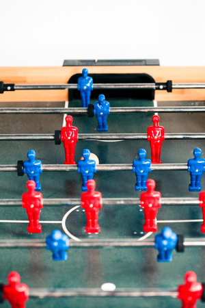 Table football game sport competition two competitors players on field. Closeup of players