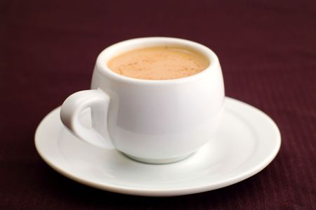 white cup of coffe on brown Stock Photo