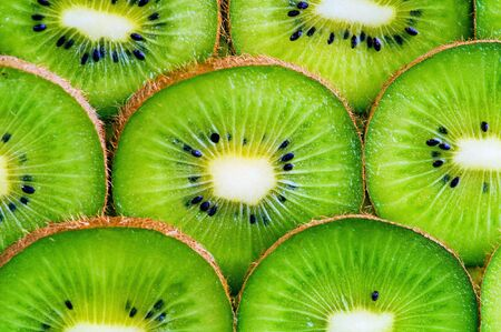 kiwi fruit slices background photo