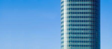 aqua skyscraper on blue sky