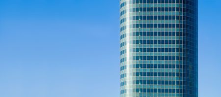 aqua skyscraper on blue sky photo