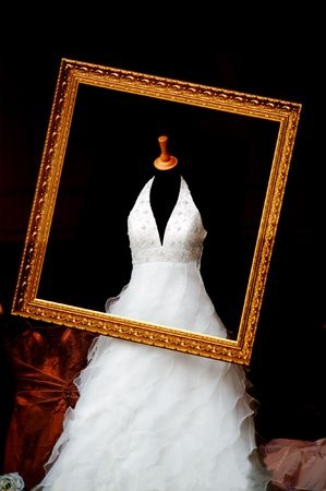 wedding dress in the gold picrture frame photo