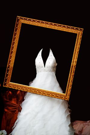 wedding dress in the gold picrture frame