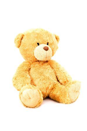sitting bear toy isolated on white photo