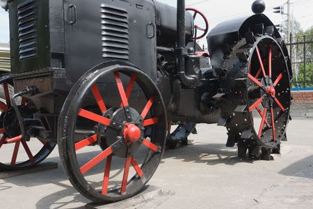 old fashioned tractor with iron wheel photo