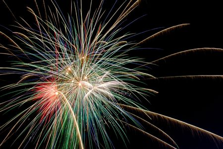 bright colored fireworks on black background photo