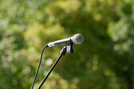 stanchion: microphone with stanchion on green background Stock Photo