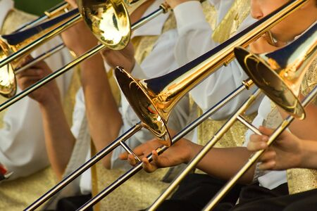 young musicians are playing on trombones Stock Photo