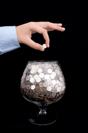 mans hand puts money into the glass
