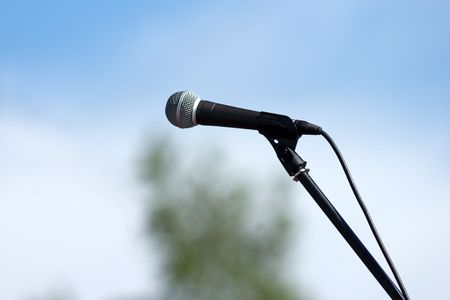 stanchion: microphone with stanchion on sky background Stock Photo