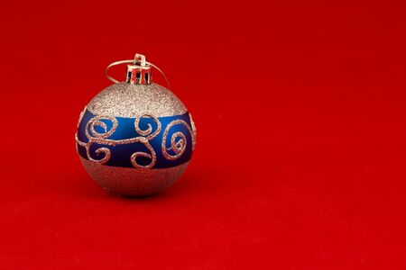 velure: new years tree decoration ball on red