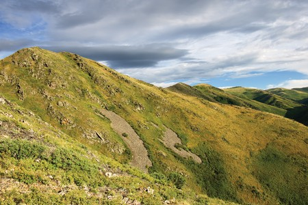 clody: mountain with rocks under clody sky