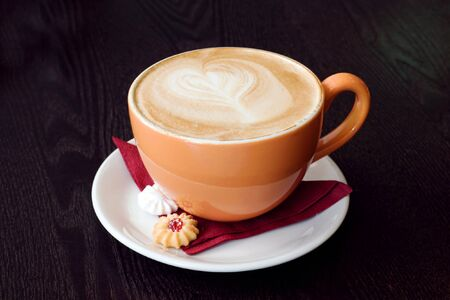 cup of cofee on brown wood table Stock Photo - 4133783