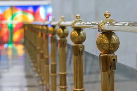 gold railing in museum hall photo
