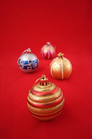 velure: new years tree decoration balls on red Stock Photo