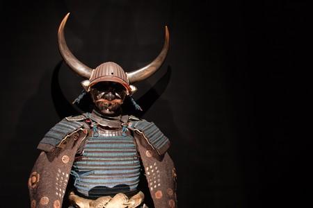 histórico samurai armadura en negro Foto de archivo