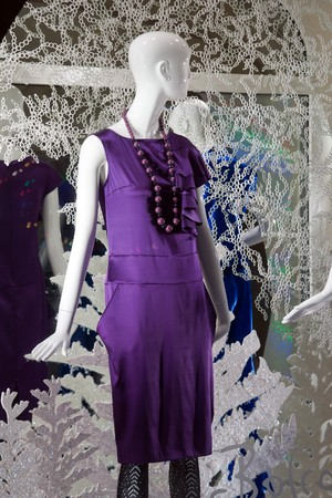 shop window with clothed mannequin
