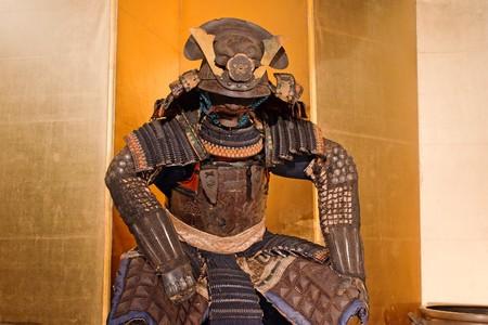 historic samurai armor on yellow photo