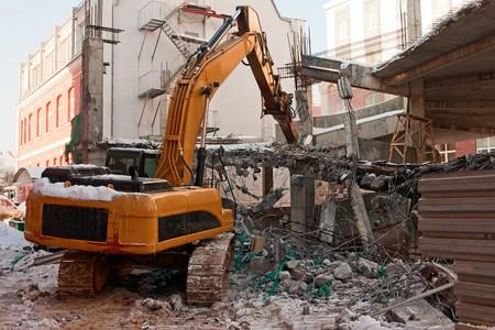 heavy dredger is demolishing a house