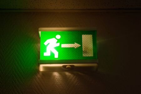 green emergency exit sign with lamp Stock Photo - 4653915