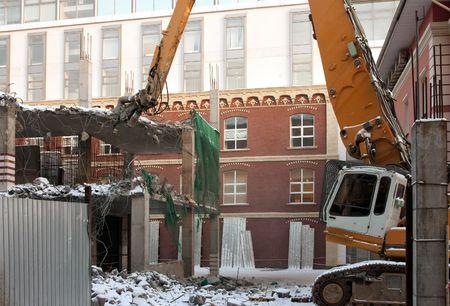 dredger: heavy dredger is demolishing a house