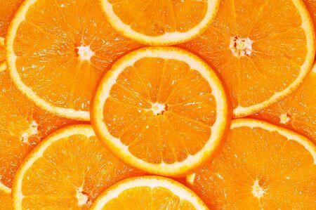 lith: ripe orange slices fruit background