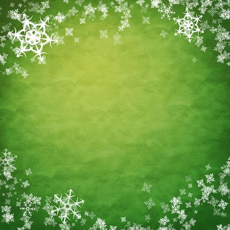 green and yellow: white showflakes over green cloth, new year background