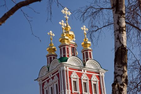 cupolas: Novodevichy Monastery wall and Church with five cupolas. Moscow, Russia. Stock Photo