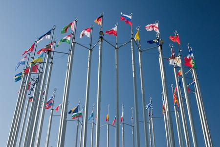 european community: europe countries flags arranged in a circle on blue sky Stock Photo
