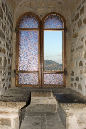 gothic window: View on mountin through stained glass window Editorial