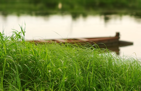 Boats on river, focus at grass on foreground,small deeep of field