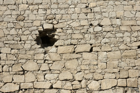 genoese: medieval Genoese stronghold wall with hole