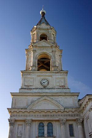 curch: high bell tower of white curch on evening light