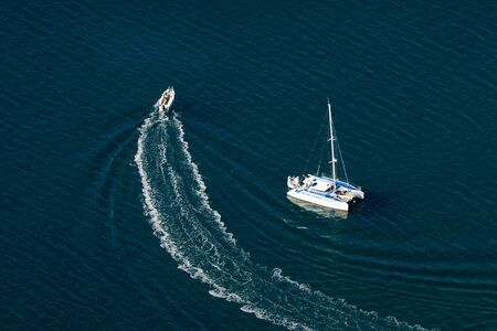 catchlight: Two boats in the blue sea