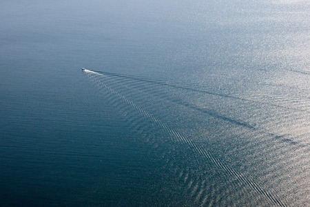 catchlight: Fast boat in the far blue sea
