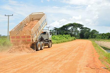 dump truck: The truck dump soil on the road