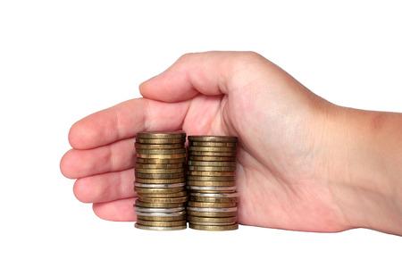 monetary: hand covers the monetary savings coins isolat Stock Photo