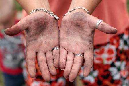 dirty female hands Stock Photo