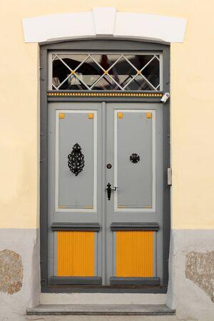 old gray door in the old town in Tallinn