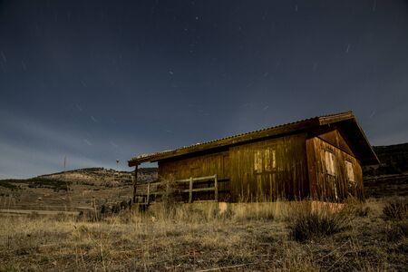 abandonment: cabaa abandoned under night sky