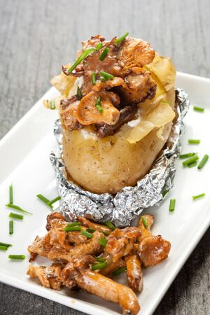 baked potato with mushrooms photo