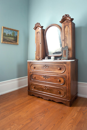wooden retro dressing table in green room
