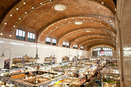 aisles: CLEVELAND, OH ? AUGUST 6, 2014: Customers and tourists shopped at West Side Market in Cleveland, Ohio in the late morning, West Side Market is located at the corner of West 25th Street and Lorain Avenue in the Ohio City neighborhood since 1912