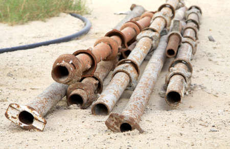 corroded: Rusty iron pipes