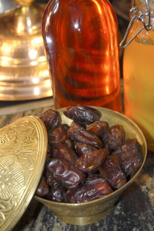 deglet: dried dates in a bowl Stock Photo