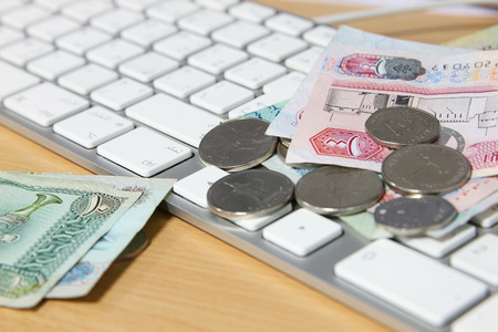 arabic currency: online transaction concept - dirhams on top of keyboard Stock Photo