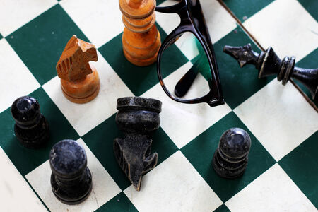 chess board: old chess board with chess pieces pilled up together