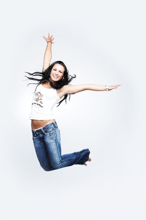girl in blue jeans jumping on white 2 photo